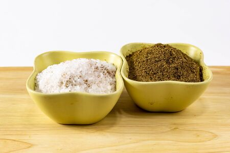 spices salt crushed cumin flavor gives on a wooden table a white background 版權商用圖片