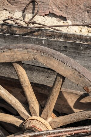 old wheel wooden knitting needles big and weathered mounted on carts close up traditional rustic