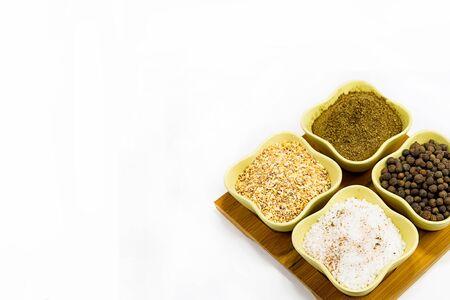seasonings set garlic salt zira on a wooden base isolated white background copy space