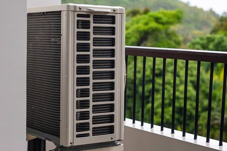 air conditioning external unit split system installed on the balcony cooling office space