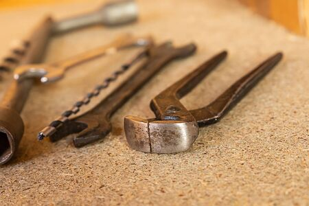 black iron tools for the construction of nippers, wrench and long drill close-up