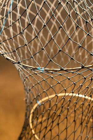 fishing nets folding and compact stack of tackles vertical close-up photos