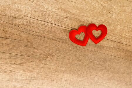 couple of hearts red symbol of love wooden background base copy space on wooden background 版權商用圖片