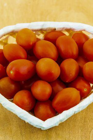 cherry tomato red ripe many vegetables full basket closeup Imagens