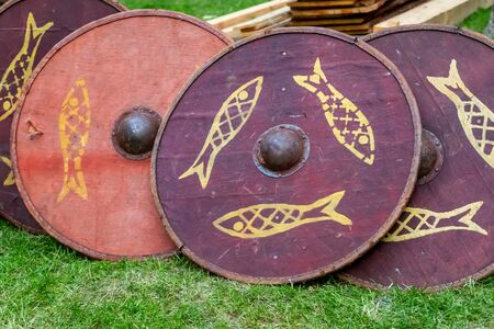 set of traditional wooden shields, round red patterned fish, disposable for ostentatious fights Reklamní fotografie