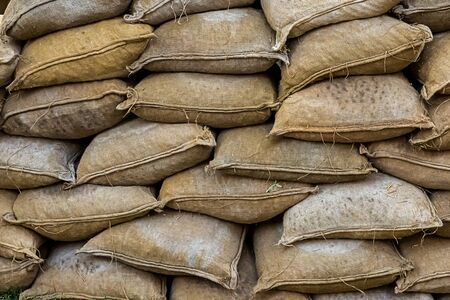 pattern folded sandbags, defensive wall against floods and hurricane background Stock Photo