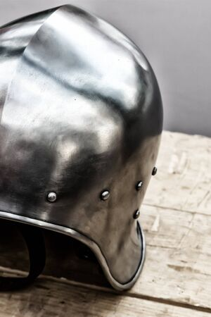 round iron helmet protection of the medieval warrior close-up stands on the table