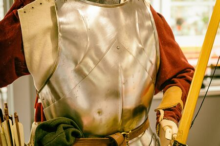 military uniform of a medieval warrior warrior archer with marks, dents from a shell