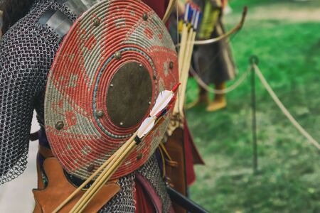 Uniforms of an ancient warrior archer consists of chain mail, a round shield and a quiver of arrows Stock Photo