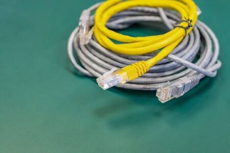 pair of lan wires with rj45 connector gray and yellow, engineering background