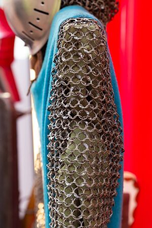 iron chain mail of many rings, part of the ammunition of a medieval warrior sleeve closeup