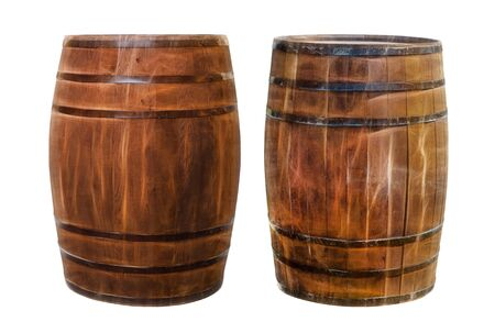 two dark brown oak barrels for storing and transporting alcohol on a white background