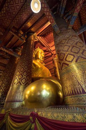 Ayutthaya, Thailand - september 25, 2017; Wat Phananchoeng a big golden Buddha statue inside the beautiful.