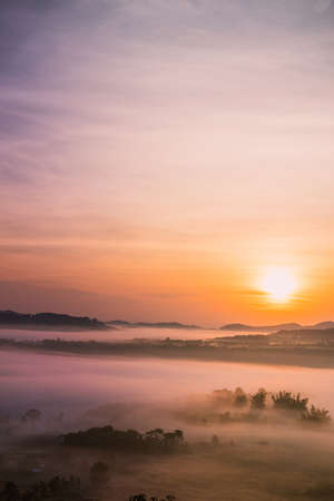 Beautiful nature sunrise Mountain Morning view point, Sun rises, at khao kho Thailand.