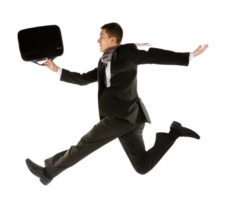 young businessman with briefcase running for success photo