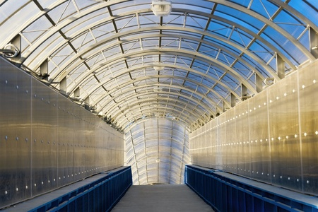 glass ceiling: Long tunnel with arch and glass ceiling