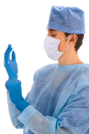 cirujano: cirujano con guantes, m�scara y escudo quir�rgica azul Foto de archivo