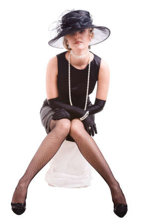 women in black with hat sitting on pedestal Stock Photo - 9338091