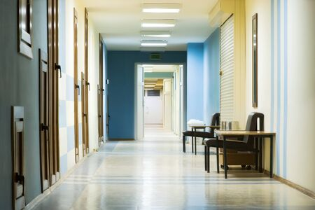 hallway: reception in hospital with corridor at night. Stock Photo
