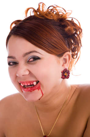 laughing funny vampire woman with fresh blood on the lips photo
