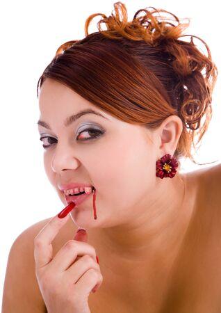 femme vampire avec du sang frais sur les l�vres et les dents Banque d'images - 9351383