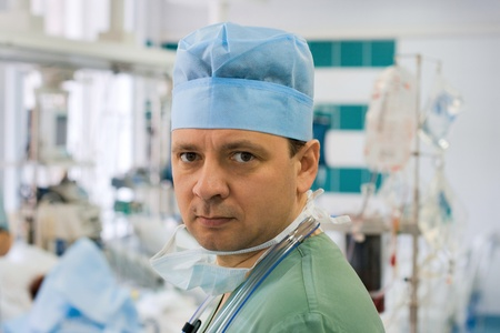 Tired male doctor in intensive care unit Stock Photo - 9351345