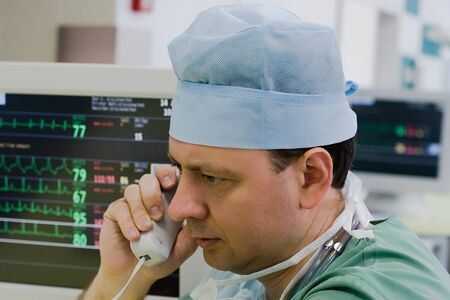 physician with phone in intensive care unit Stock Photo - 9357987
