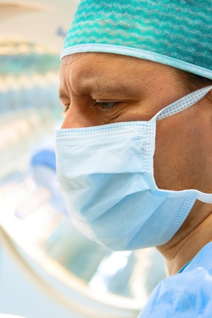 surgeon with surgical lamp on background Stock Photo - 9357982