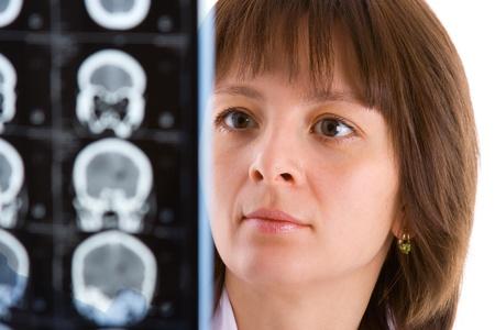 female doctor looking at tomogram photo