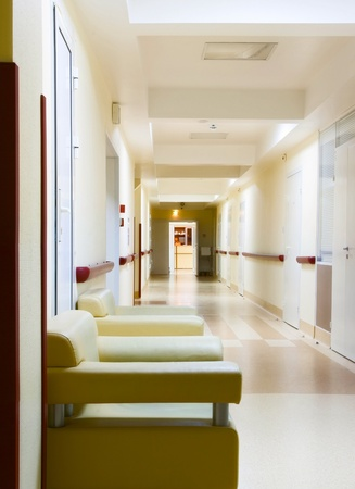 long yellow corridor in hospital photo