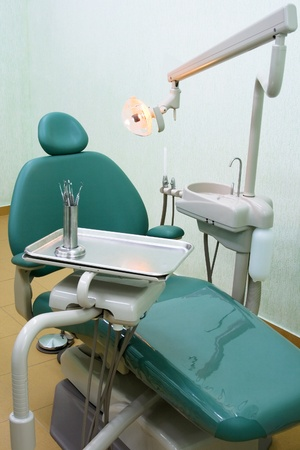 Dentists workplace with chair and tool photo