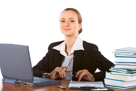 young successful businesswoman with laptop and spectacles photo