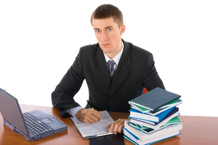 young successful businessman with laptop and books photo