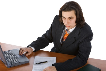 young successful businessman typing on laptop photo