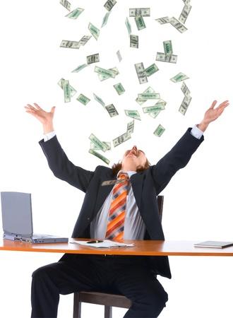 dropped: joven empresario en la Oficina y ca�da de dinero, aislados en fondo blanco Foto de archivo