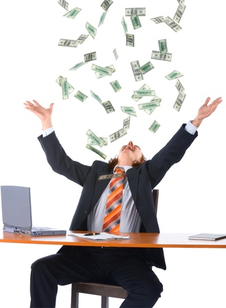 dropped: young businessman in office and falling money, isolated on white background