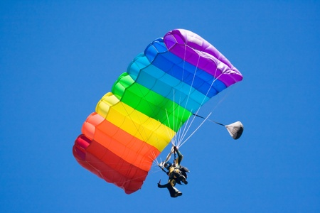 parachuting freefall in blue sky Stock Photo
