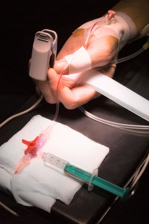 patients hand with catheter in operation room photo