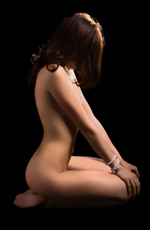naked girl black hair: young meditating naked women on black background Stock Photo