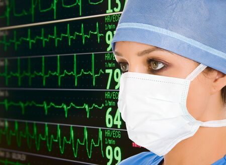 ekg: female doctor with ecg monitor on background