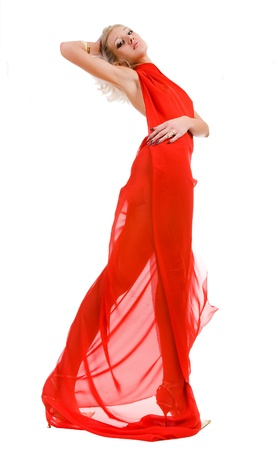 young blonde attractive woman in red fabric photo