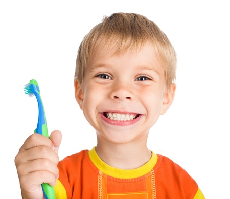 smiley boy cleans a teeth isolated on white background photo