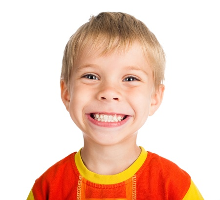 smiling teeth: happy smiling five-year-old boy isolated on white background