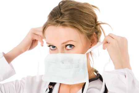 Young attractive female doctor dress mask Stock Photo - 9597080