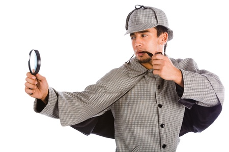 sherlock holmes with pipe and magnifying glass photo