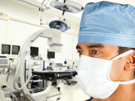 Male asian surgeon in modern operation room