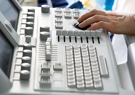 Ultrasound medical device keyboard with doctors hand. Image with shallow DOF. Stock Photo