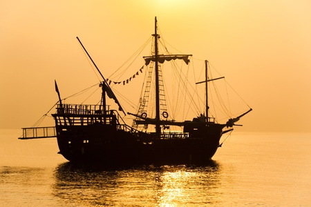 schooner: Schooner silhouette at sunset