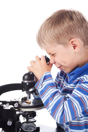 little boy with microscope isolated on white