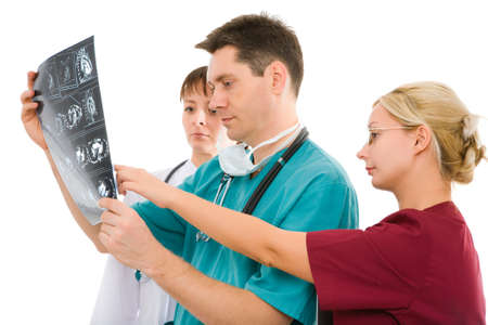 Three male and female doctors with x-ray tomogram photo